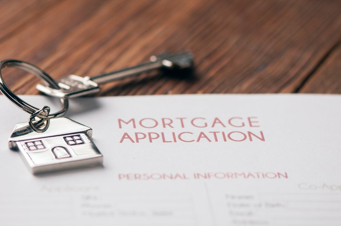 Mortgage application with key.