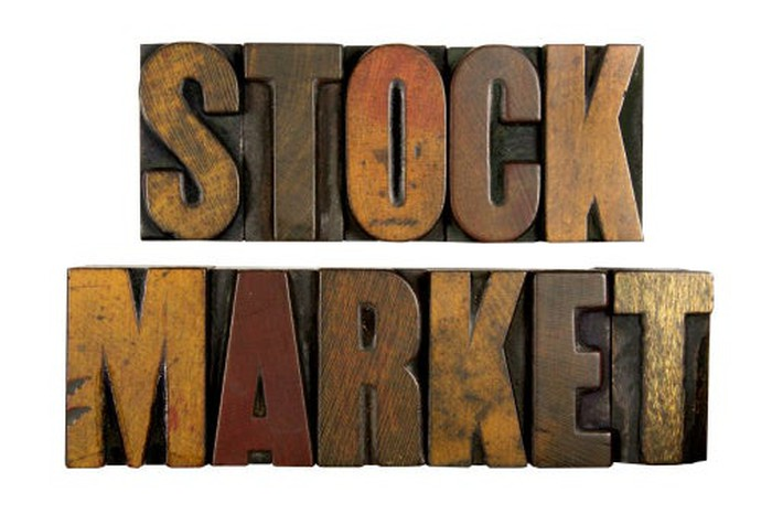 Image of the words Stock Market carved in wood.