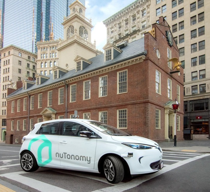 A white Renault Zoe with nuTonomy logos in front of the Old State House in downtown Boston, Massachusetts.