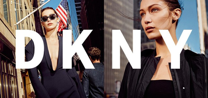 An ad for DKNY featuring two women on the streets of a city.