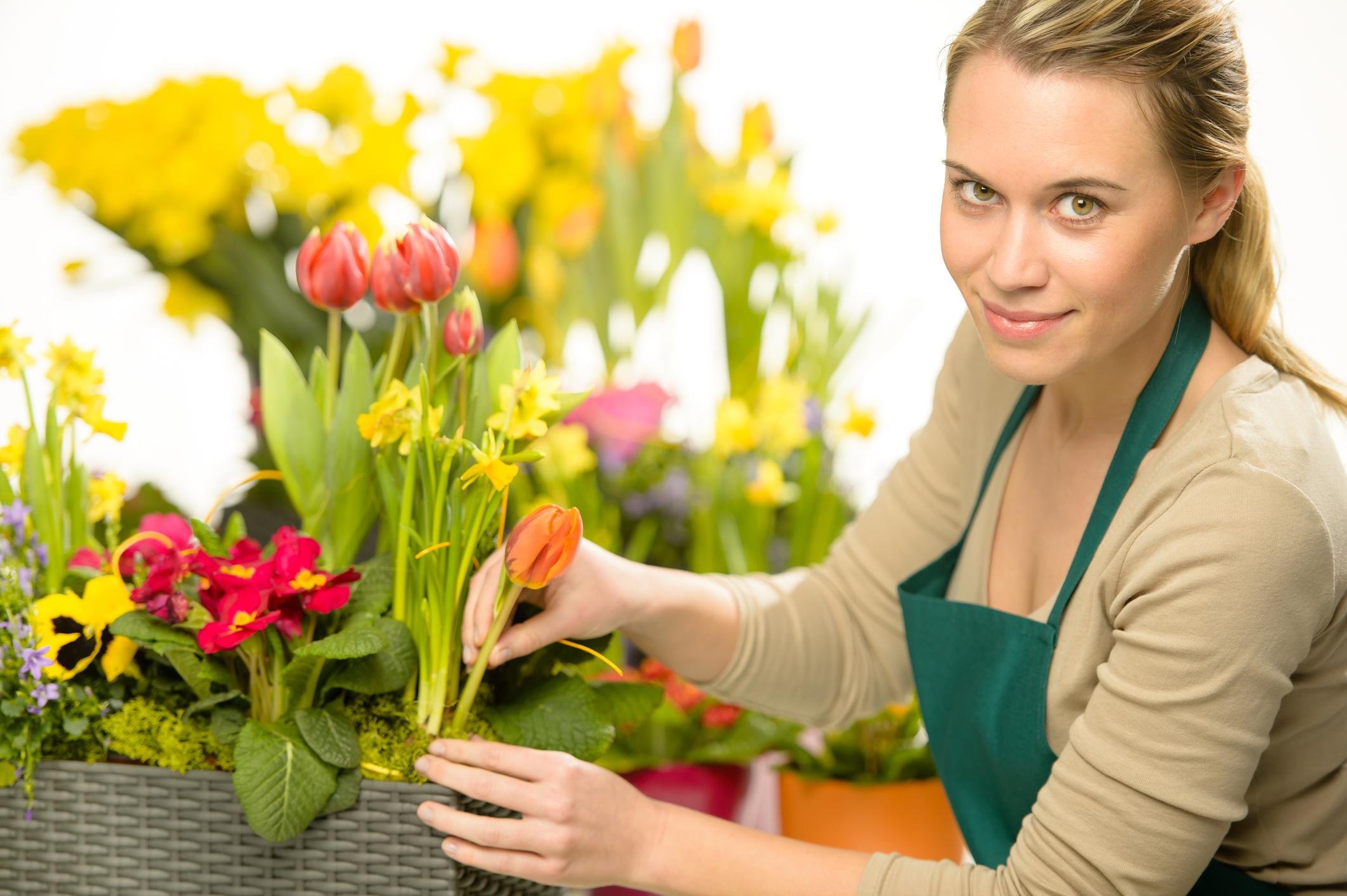 A florist prepares a bouquet.