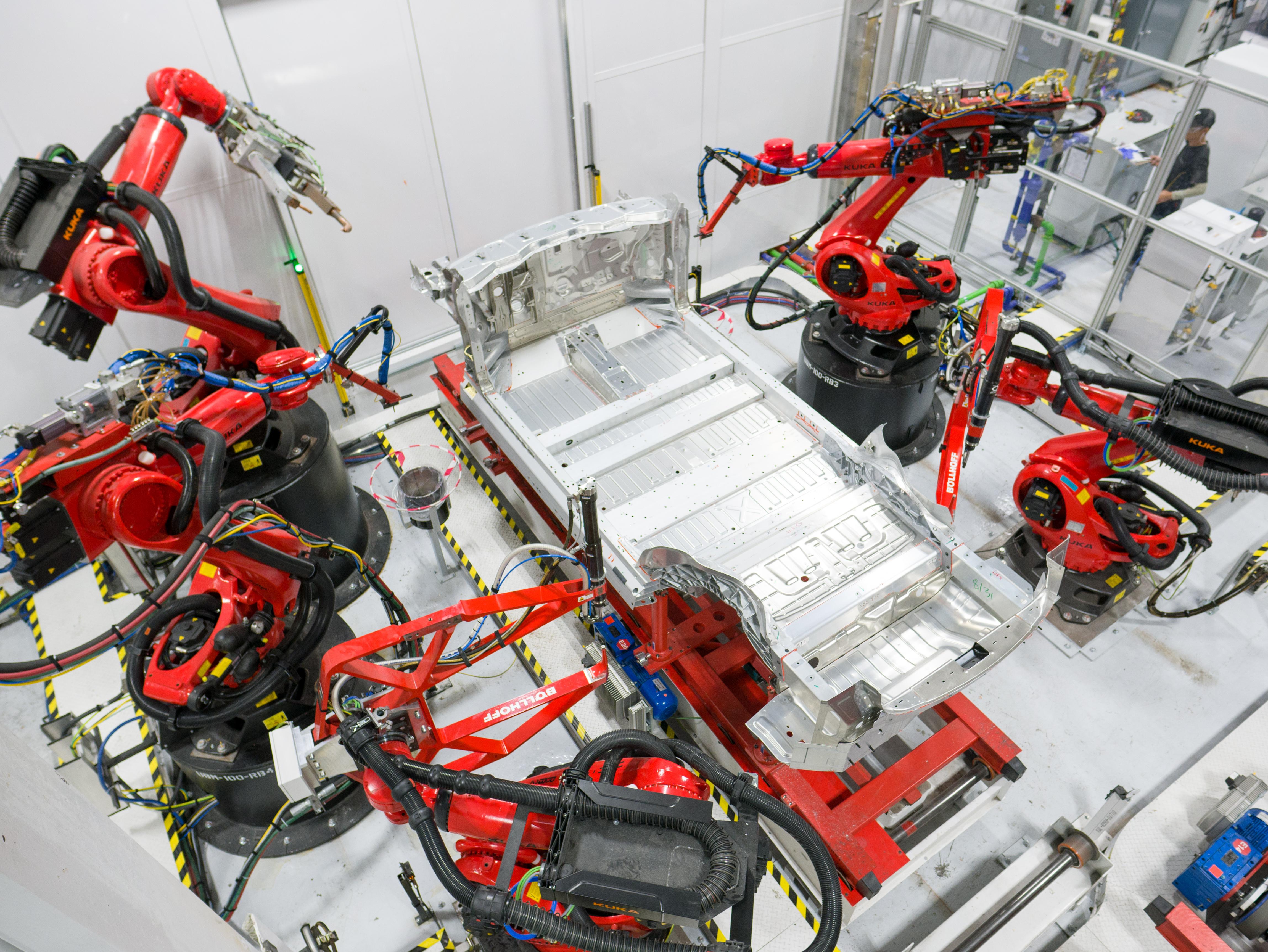 Assembly begins on a Tesla vehicle.