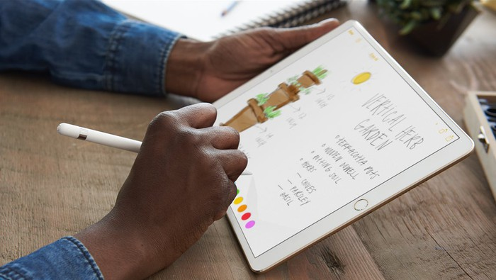 A person using Apple's iPad Pro with an Apple Pencil.