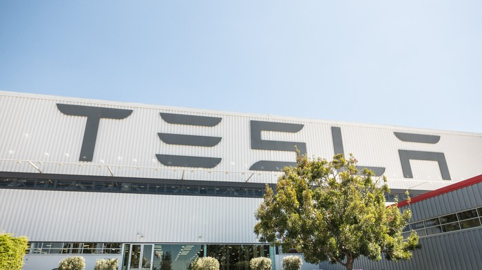 """Tesla"" in large, capital letters on the outside of Tesla's factory."