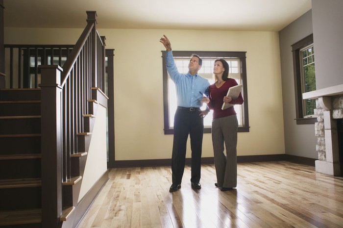 A home inspector walks in a house.
