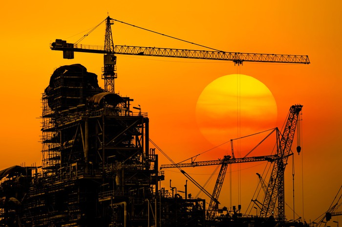 An industrial construction site at sunset.