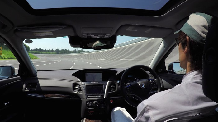 The view from the back seat of a Japan-market Honda Legend sedan in a self-driving test on a race track.
