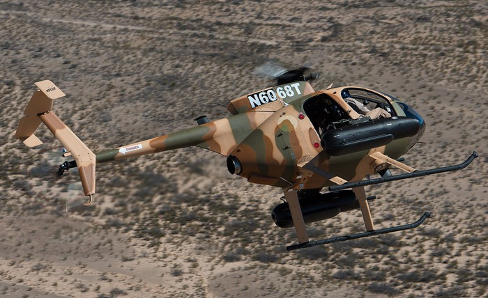 A camouflage painted MD 530.
