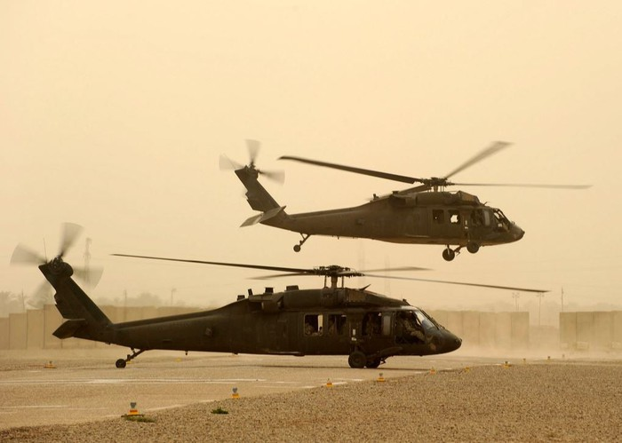 Two UH-60 Black Hawk's taking off.