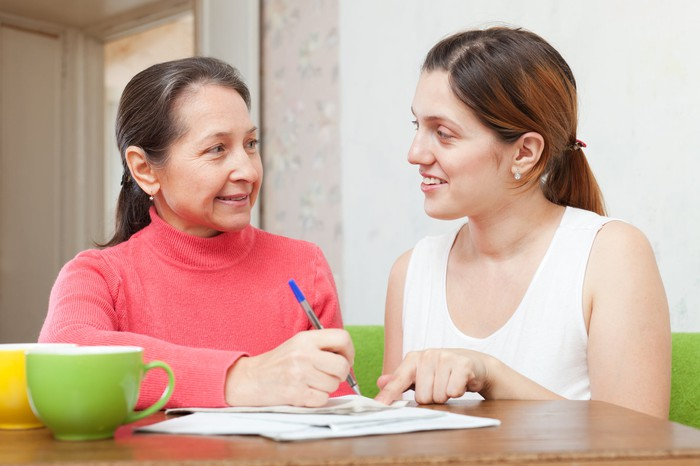 Mother and daughter looking at student loan documents
