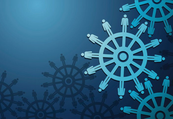Vector image of wheels with cogs in the shape of business people on blue background