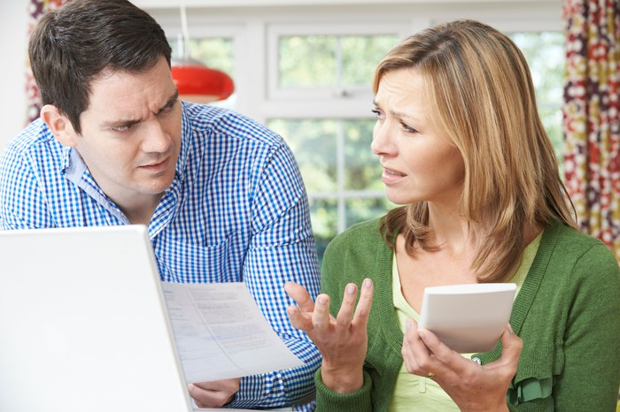 Worried couple discussing bills