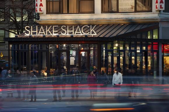 The facade of a Shake Shack restaurant.