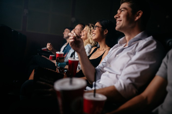 People watching a movie in a theater.