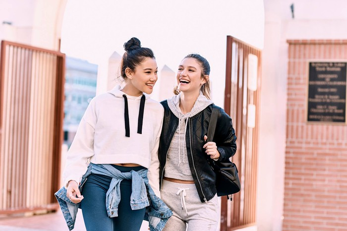 Two smiling teenagers are shown outdoors, wearing Charlotte Russe fashions.