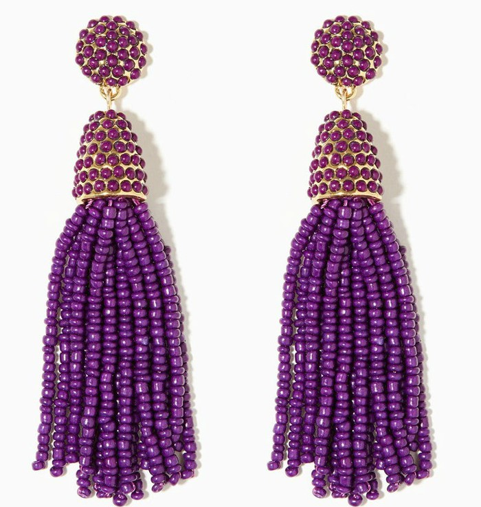 A pair of long purple earrings.