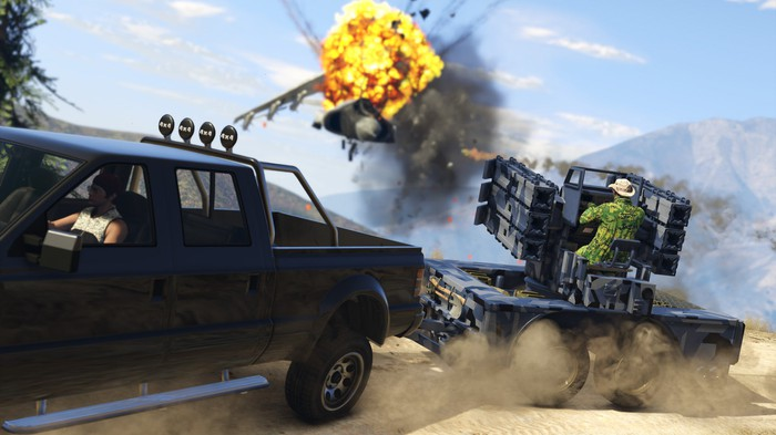 A truck towing a person manning a gun turret in Grand Theft Auto V.