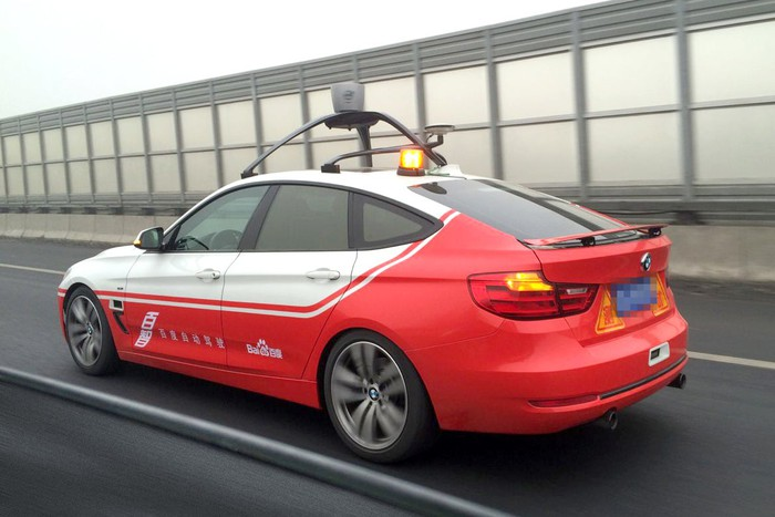 Car equipped with self driving hardware.