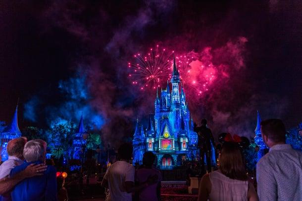 Onlookers enjoy the nightly Walt Disney World fireworks display over Cinderella Castle.