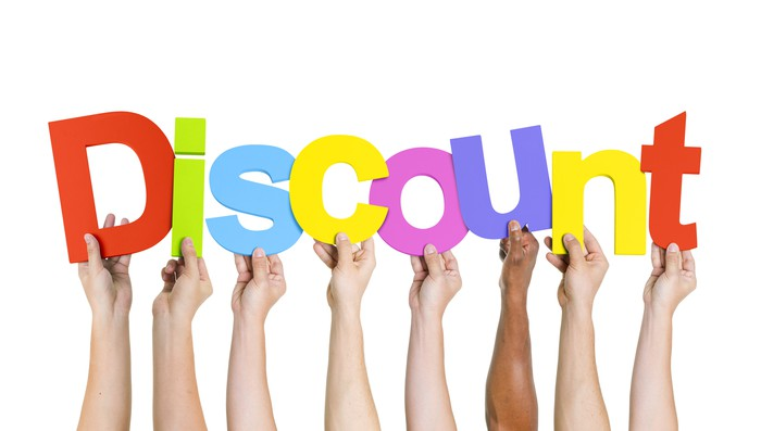 "Hands hold up colorful letters to spell the word ""discount."""