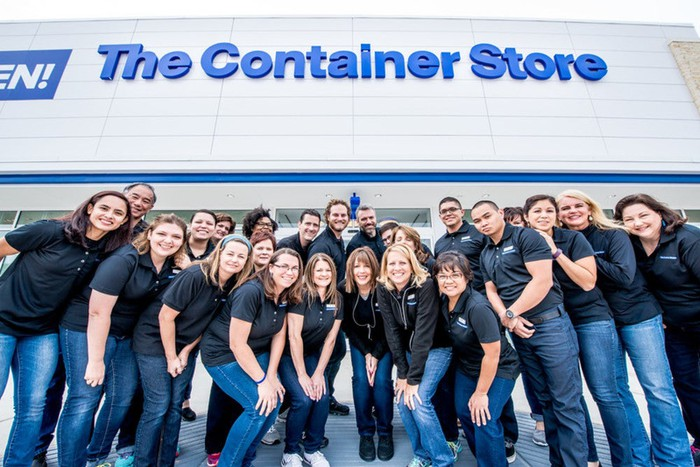 A group of Container Store employees in front of a store