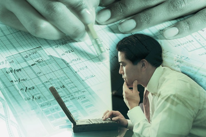 Business owner looking at financials.