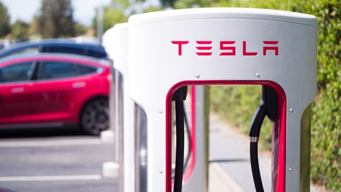 Tesla vehicles at a Tesla Supercharger location