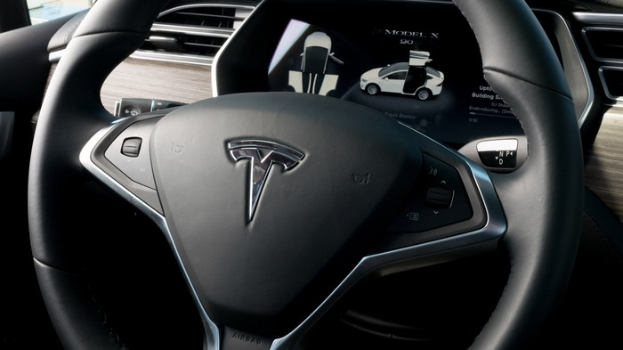 Tesla steering wheel with Tesla logo