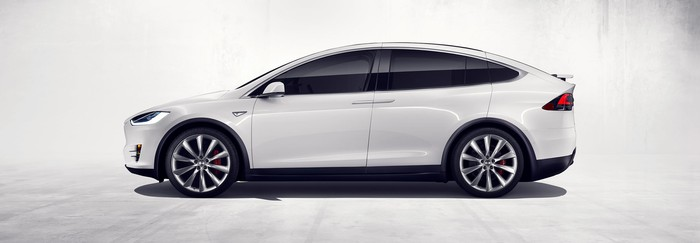 side view of white Tesla Model X