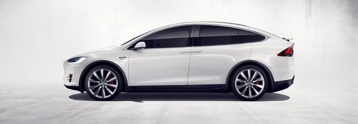 side view of white Tesla Model X