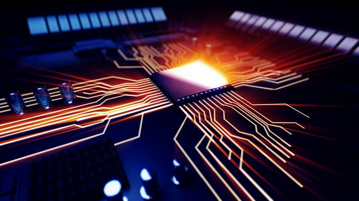 Illuminated circuits branch out from a computer chip.