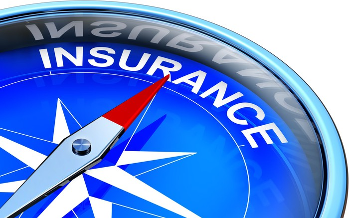 """Compass with needle pointing to the word """"insurance."""""""