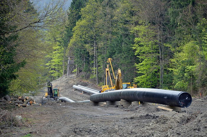 A pipeline under construction in the mountains.