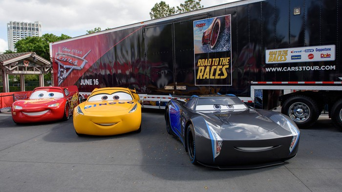 """Three cars from the """"Cars 3"""" tour, kicking off at Disney Springs."""