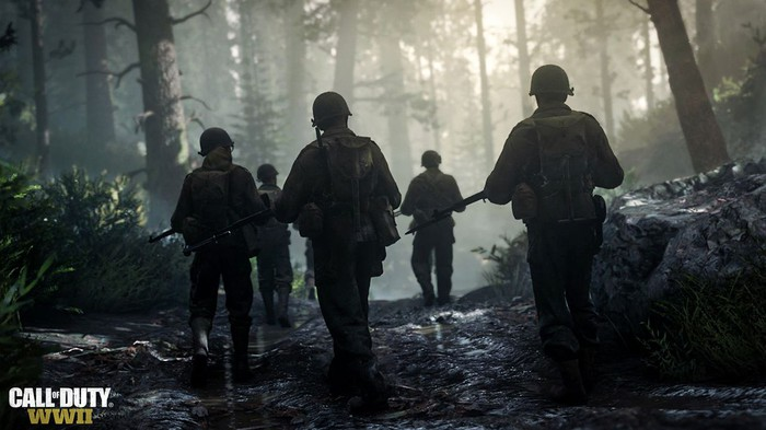 """Five soldiers walk through a forest in """"Call of Duty: WW2"""""""