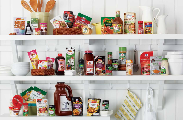 Kitchen shelves displaying McCormick products.