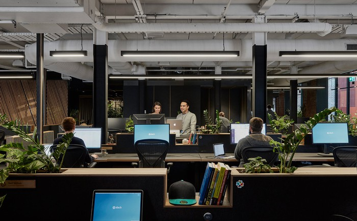 Employees working at Slack's office in Melbourne