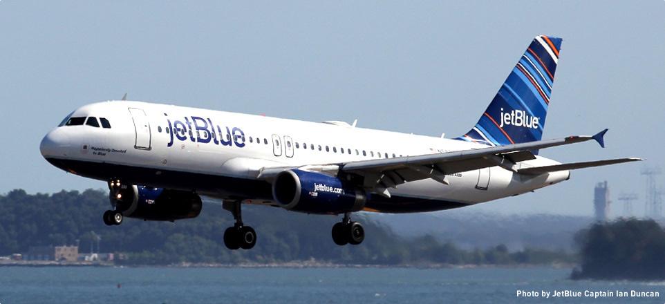 A JetBlue Airways plane taking off.