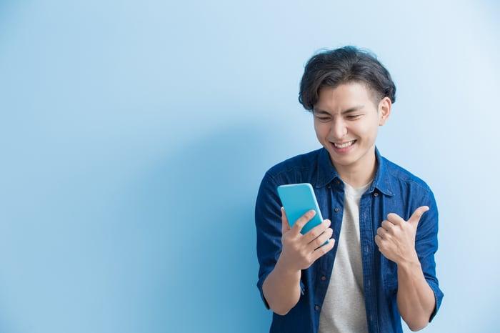 A man uses a smartphone.