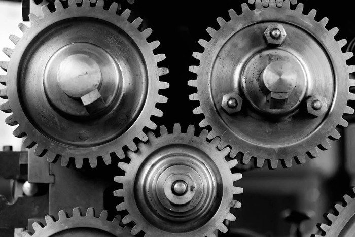 Black and white photo of old gears.