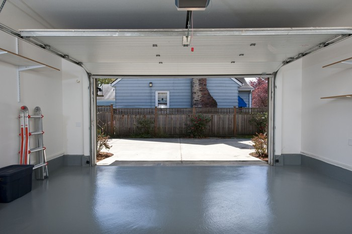 Looking out from an empty garage with the garage door open