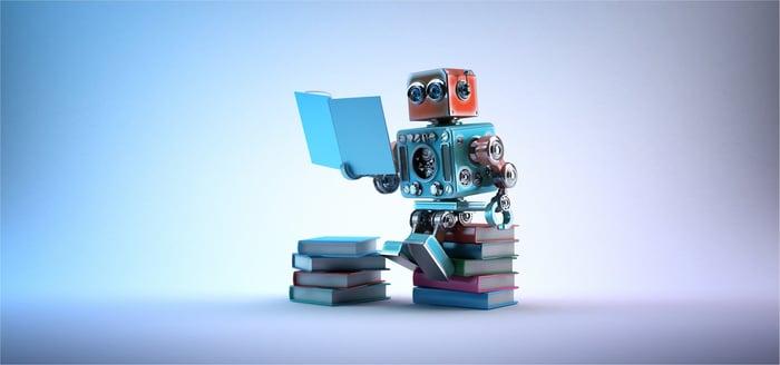 A robot reads a book.