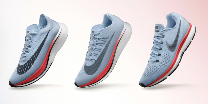 Three Nike Zoom Vaporfly 4% running shoes lined side by side.