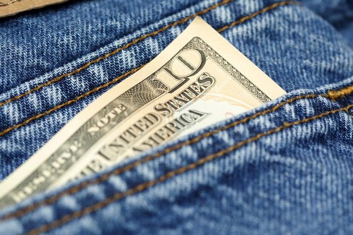$10 bill in jeans pocket.