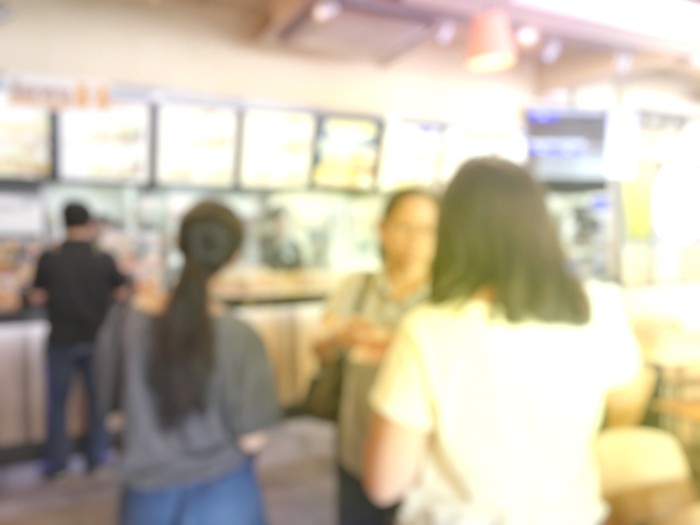 People waiting in line at a fast food restaurant