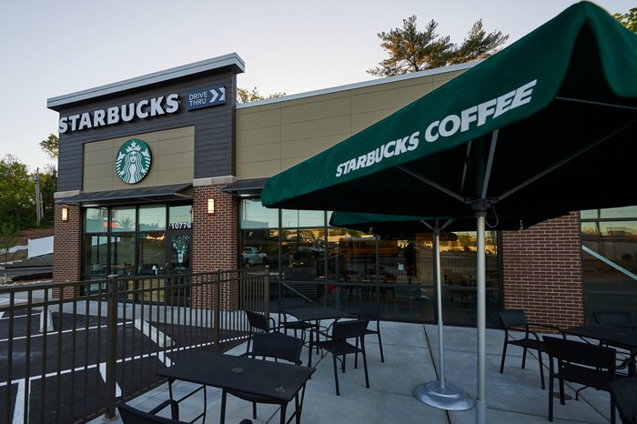 The exterior and patio area of a Starbucks store.
