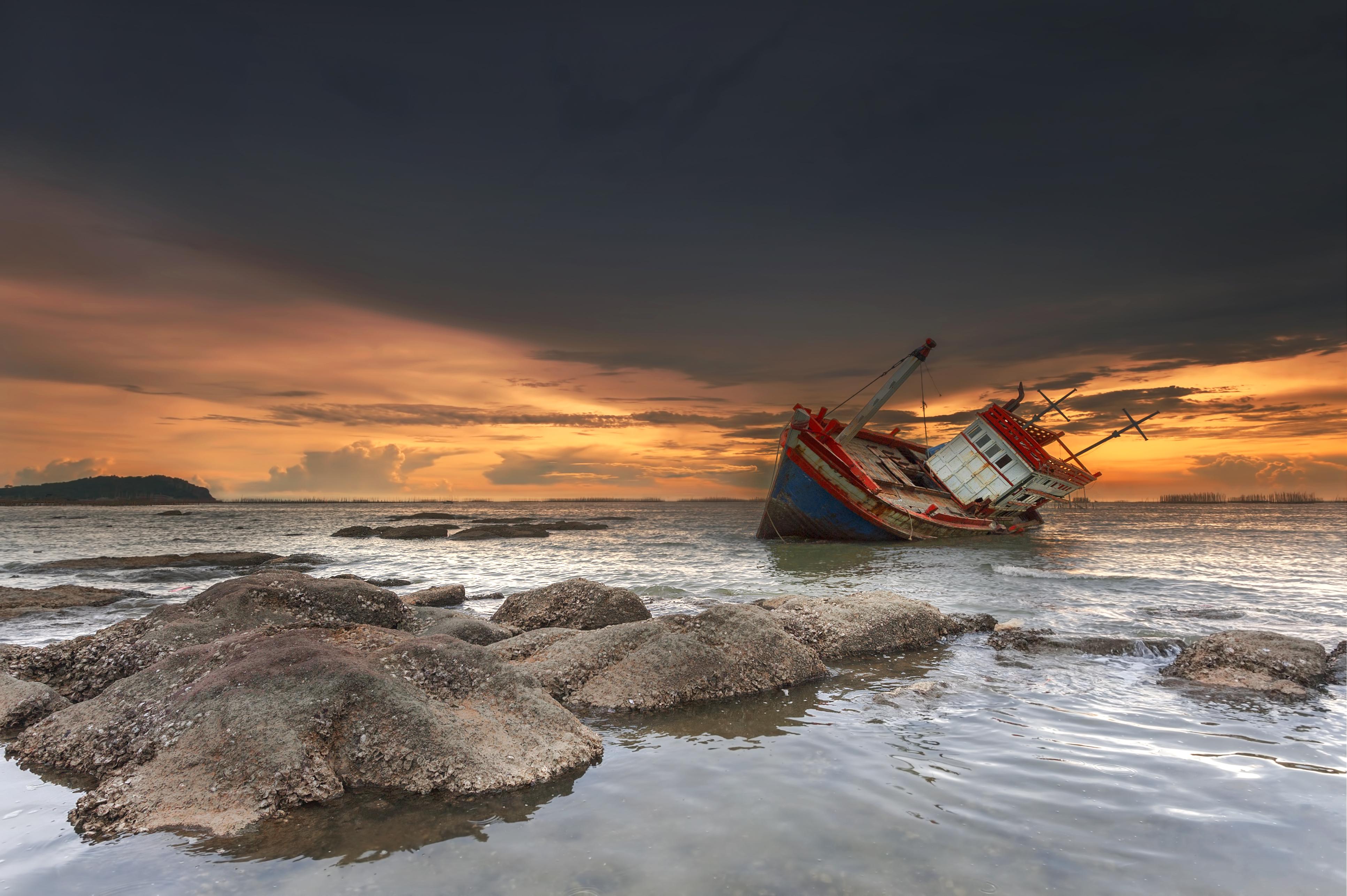 A shipwreck at sunset.