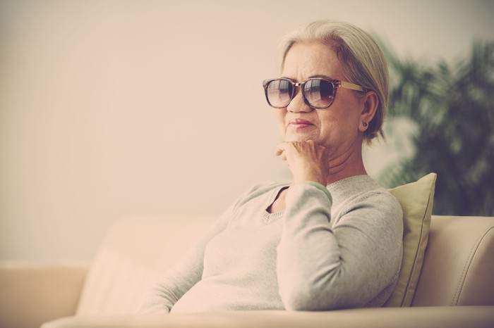 senior woman wearing sunglasses while sitting