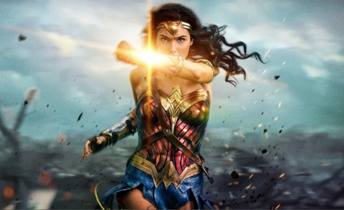 Wonder Woman deflects bullet with her bracelet.