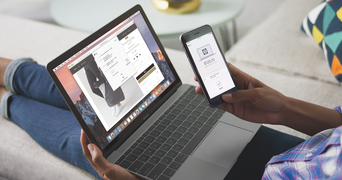 Person using Apple Pay on MacBook and iPhone